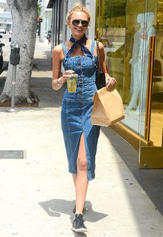 Victoria's Secret Angel, Romee Strijd, trophied a denim midi dress with a navy neckerchief (turning up the Western vibes). Romee then added low-top leather trainers, a chain-strap shoulder bag and some rock-star aviator sunnies