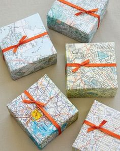 Wrap guests' gifts in maps that represent your wedding locale, and finish with a flourish of coordinating ribbon.  Also would be a great idea for a going away gift for a special vacation!