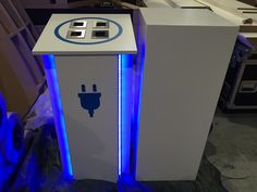 Custom made charging pod with LED accents. Accompanied by a standard plinth.
