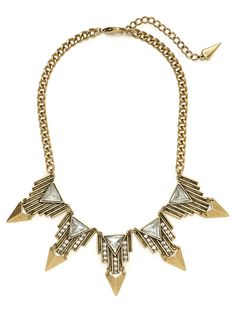this necklace is a metaphor for the dress i have picked, because it shares the similarities of having gold and silver. In addition, when looking at the dress we are able to tell that it has an aztec print embedded in the fabric, which can be shared with the aztec shapes in this necklace. Overall this piece has a classy and cultured look, which also can be recognized in this dress.