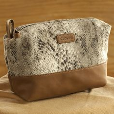 Snake Print With Tan Faux Leather Travel, Cosmetic Pouch. https://www.qtrove.com/products/snake-print-with-tan-faux-leather-travel-cosmetic-pouch Spacious Travel kit, Cosmetic kit with a zipper pocket inside. Best for travelers https://www.qtrove.com/products/snake-print-with-tan-faux-leather-travel-cosmetic-pouch