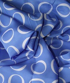 Vintage 1990s John Kaldor geometric polyester crepe de chine fabric - one yard. $9.00, via Etsy.