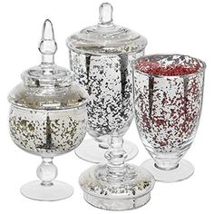 There's something elegant about using mercury glass urns in your home design. Try to group odd lots together. (Usually three objects together is acceptable.) This trio would look lovely off to the side on a mantle or decorative ledge. Apothecary Jars Wedding, Apothecary Jars Bathroom, Wall Mounted Shelves, Ceramic Planters, Jar Storage, Mercury Glass, Decorating Blogs, Hand Blown Glass, Home Decor Items