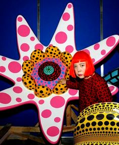 """Yayoi Kusama is a Japanese artist and writer born in 1929. Throughout her career she has worked with painting, collage, soft sculpture, performance art, and environmental installations. An influential artist not only in Japan but also throughout the world. Her work and intricate designs inspired the likes of Andy Warhol and Claes Oldenburg to break out of the norms and adapt a more avant-garde like approach to art. This artwork is titled """" Flowers that bloom at midnight"""" which started in…"""