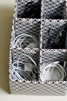diy: how to organize your cords and cables}Supplies:  Shoe box(es) Wrapping paper (or any kind of decorative paper) Heavy cardboard pieces (cut from a shipping box or old shoe box)  Tape/glue Ruler  Labels    Go to website for instructions :)