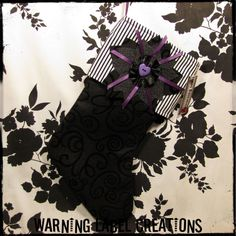 Gothic Christmas Stocking - Burtonesque Purple, Black and White Stripe - Warning Label Creations. $30.00, via Etsy.