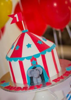 Cute circus tent cake at a Carnival birthday party!  See more party ideas at CatchMyParty.com!