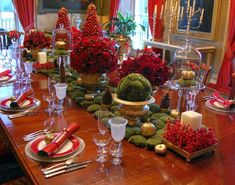 Festive and formal table setting...pretty!  I love pulling all of my crystal and other random items out at the holidays and filling them with unique flowers, berries, and candles
