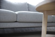 Close up of the Lennon Sofa in James Dunlop Wool Felt colour Pewter. Shown here in cm studio's Cross Street Project.
