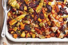 With a rainbow of winter root veg, pork sausages and pesto sauce, this easy traybake recipe is perfect for family dinners. Find Dinner ideas at Tesco Real Food. Tray Bake Recipes, Sausage Recipes, Veggie Recipes, Vegetarian Recipes, Dinner Recipes, Cooking Recipes, Healthy Recipes, Healthy Dinners, Pork Recipes