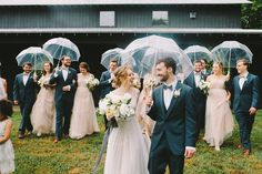 Wedding party shot with umbrellas | Image by Erin McCall Photography