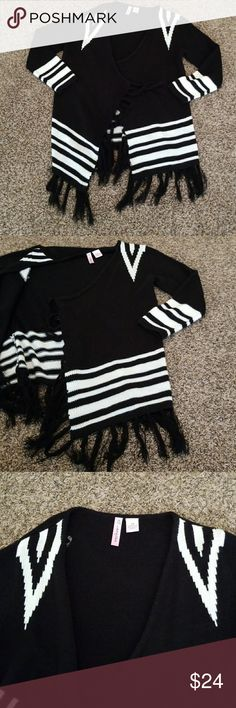 Black & White Cardigan Trendy tribal Black & White cardigan with fringe accents around the bottom seam. Never been Worn! Great for the up and coming fall season! Jackets & Coats