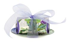 All tied up with a bow! One of Michel Design Works luscious large bath soaps with a matching glass soap dish.