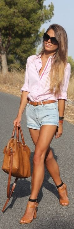 Pink and faded blue denim go well together--it's one of my favorite combos. The shoes, bag and her tan all work together, and those heels give her a long, slender silhouette. A great look!  ...Ron