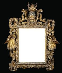 A NORTH EUROPEAN PARCEL-GILT AND POLYCHROME-DECORATED MIRROR  MID-18TH CENTURY, PROBABLY GERMAN