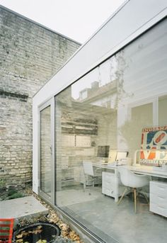 Wedged between two old houses in a quiet Swedish street is this unsuspecting townhouse, designed by Elding Oscarson. The contemporary building is a dramatic contrast to the neighboring buildings with its refreshing neutral palette and iconic furniture including a Knoll Bertoia Diamond chair, Fritz Hansen Swan chair, Fermob Luxembourg outdoor furniture, and an Eames Moulded Plastic Armchair.