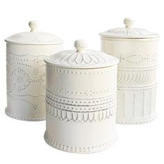 3 earthenware lidded canisters with raised detailing and a lightly weathered finish.  Product: Small, medium, and large lidded c...