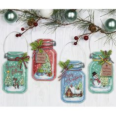 Preserve some of the holiday spirit with the counted cross stitch Christmas Jar Ornaments by Dimensions.