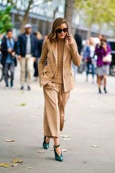 paris fashion week street style spring 2018 olivia palermo taupe chunky sweater cropped trousers vest green heels getty images