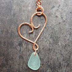 Wire wrapped, hand forged, hammered copper heart pendant with sea glass and 18 inches copper chain. by Minishsdesigns on Etsy https://www.etsy.com/listing/232540185/wire-wrapped-hand-forged-hammered-copper