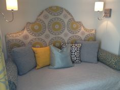 HomeGoods pillows add comfort and punches of color to this built-in daybed.