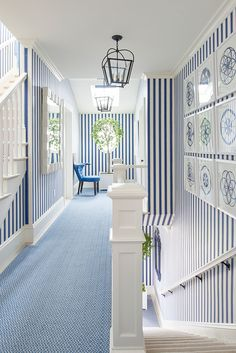 Coastal Living 2017 Idea House | Mark D. Sikes showcased his signature blue and white color palette throughout the home. The entry, stairway and center halls were outfitted in a custom stripe wallpaper and timeless Plantation Small Lanterns by E.F. Chapman.  #circalighting