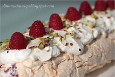 Meringue roulade with rose petals and freshraspberries