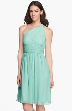 Mint Green Bridesmaid Dress. A beautiful ruched band cinches the Empire-waistline of a flowing, single-shoulder chiffon dress. By Donna Morgan