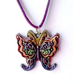 Items similar to Sparkly Rainbow Butterfly Pendant on Purple Suede on Etsy Paint Brass, Rainbow Butterfly, Butterfly Pendant, Jewelry Design, Unique Jewelry, Hand Painted, Pendant Necklace, Trending Outfits, Handmade Gifts