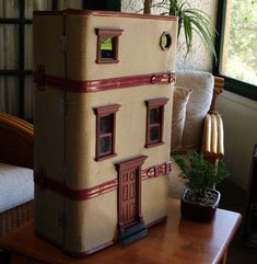 Well this just about rolls everything I adore into one perfect little package– miniature crafts, the golden age of travel and tiny fairy doors to another world. Marisa and David ofQueanbeyan, Australia make dollhouses out of beautiful old suitcases they come across. They love to make old things new