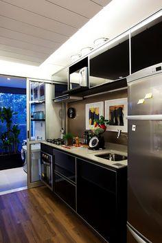 Integração traz amplitude a apartamento de 51 m²