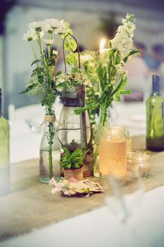 Rustic flower centrepieces ~ Amy & Tom's Rustic Country Wedding