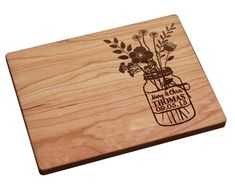 A cutting board you can have engraved with names and a wedding anniversary date.