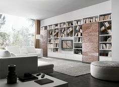 Bookcase with a matt bianco candido lacquered structure and Cooper stone sliding doors.