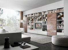 Bookcase with a matt bianco candido lacquered structure and Cooper stone sliding doors.__ Libreria con struttura laccato opaco bianco candido, ante scorrevoli in pietra Cooper.