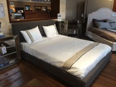 Tufted Gray Headboard From Living Spaces.