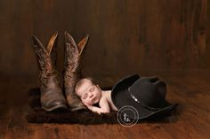 Kemptville Newborn Photographer. Sweet Baby boy resting his arms and head on his daddy's cowboy boots. http://anellerichardsonphotography.com/blog/newborns/the-little-cowboy-kemptville-newborn-photographer/