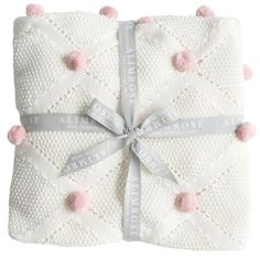 A gorgeous 100% organic cotton knit baby blanket featuring little pink pom poms. Super soft...