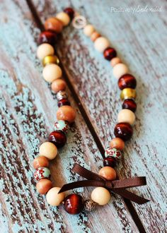 Make this DIY Wood Bead Necklace! It's perfect for fall, and Amy from Positively Splendid shows us how! Fall Jewelry, Jewelry Crafts, Beaded Jewelry, Handmade Jewelry, Jewlery, Crystal Jewelry, Jewelry Art, Silver Jewelry, Wooden Bead Necklaces