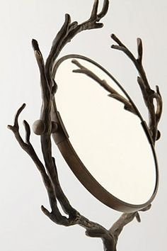 Enchanted brass twigs frame this fairy-tale vanity mirror.