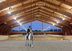 Indoor Dressage Arena at Night <3 I want to know where this is. From B & D Builders.