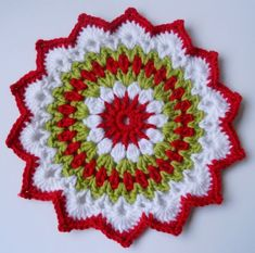 Made from Patons Smoothie in traditional Christmas colours. Made from a pattern by Camilla Lindberg The mandala measures approx Mandalas are a modern version of a doily, ideal for table decorations, under p. Crochet Christmas Decorations, Christmas Crochet Patterns, Crochet Flower Patterns, Crochet Designs, Crochet Flowers, Crochet Wool, Crochet Chart, Thread Crochet, Crochet Gifts
