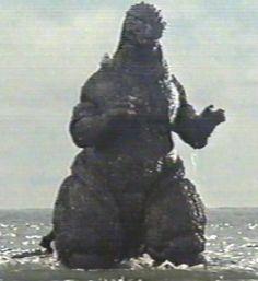 Godzilla emerging from the ocean.