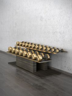 This Luxury Dumbbells set forms a rack and pairs of dumbbells weighing from 2 to 20 kilograms. Dumbbells combines in itself very simple design, but unusual in similar accessories combination of wood and stainless steel. Home Gym Basement, Gym Room At Home, Home Gym Decor, Fitness Station, Gold Wood, Black Wood, Dream Home Gym, Luxury Gym, Yoga Studio Design