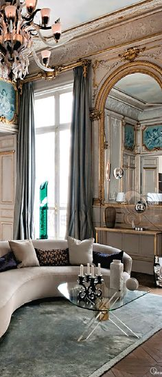 We love this room for its real parisian look with the older style windows and wall features combined with the more modern pieces of furniture. The colours here are lovely too