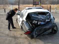 """This is what a police car looks like when a train runs it over...was working that night.  EPIC.  """"THE DAMAGE IS DONE, THE DAMAGE IS DONE."""""""
