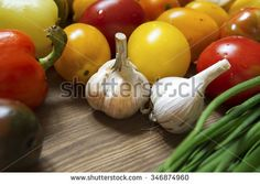 Garlic bulbs and vegetables still life on wooden table. Shutterstock, photography, red, green, yellow, vegetarian, organic, food photography