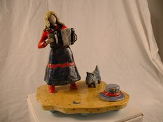 Accordion Girl with small dog by PlatypusPuff, via Flickr