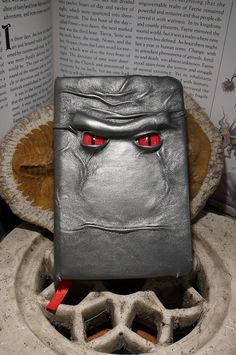 Mythical Beast Book (Gunmetal leather with Red eyes). $35.95, via Etsy.