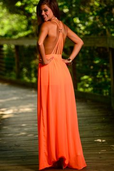 If you're looking to turn heads anytime soon, this neon orange maxi is the one for you! We are obsessed with the strappy back and the bold color will be sure to have all eyes on you!